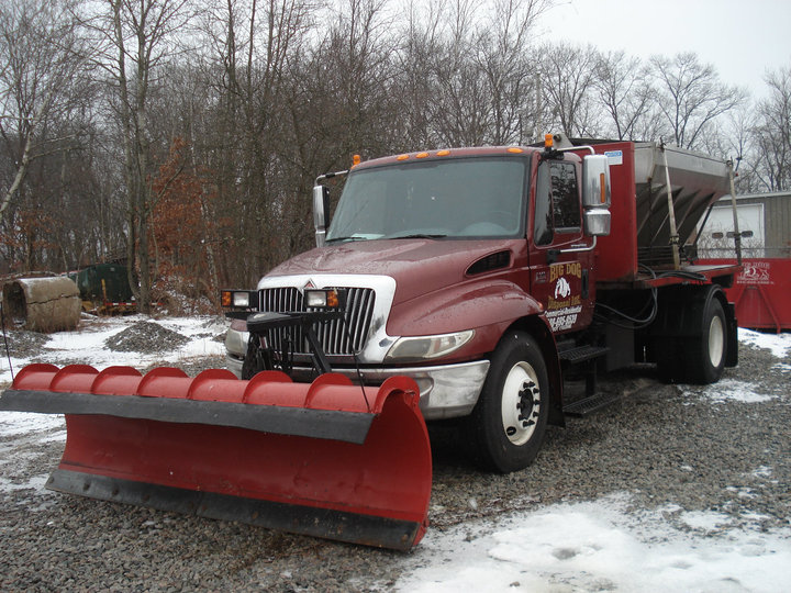 hook lift - plow sand - moves trash sand snow salt